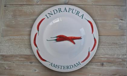 Bord Indrapura restaurant in Amsterdam totaal bedrukking onder glazuur
